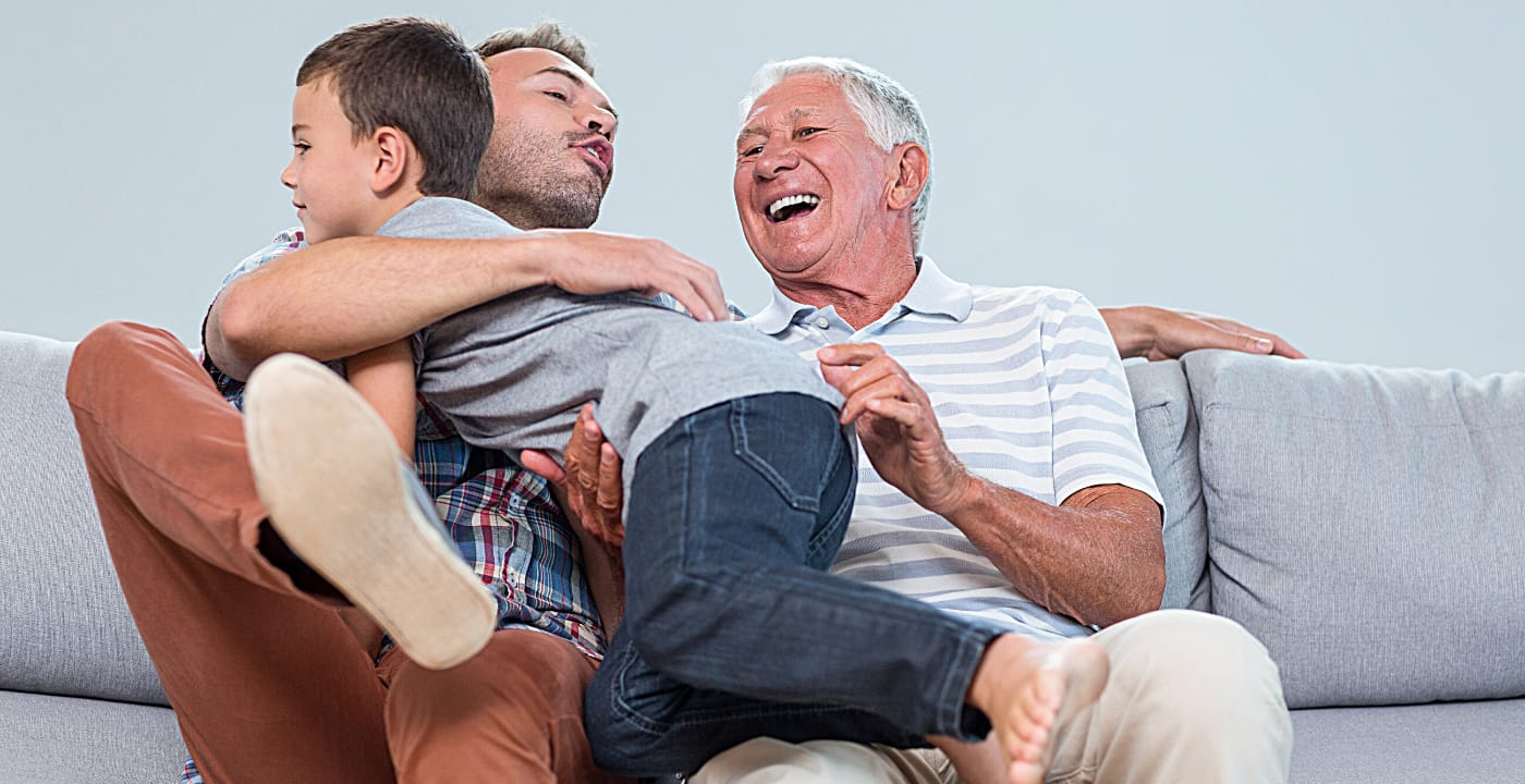 dad with son and grandpa sitting on a couch